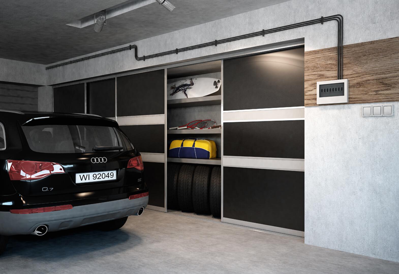 Bardzo duża zabudowa w czarnym kolorze drzwi przesuwnych w garażu samochodowym