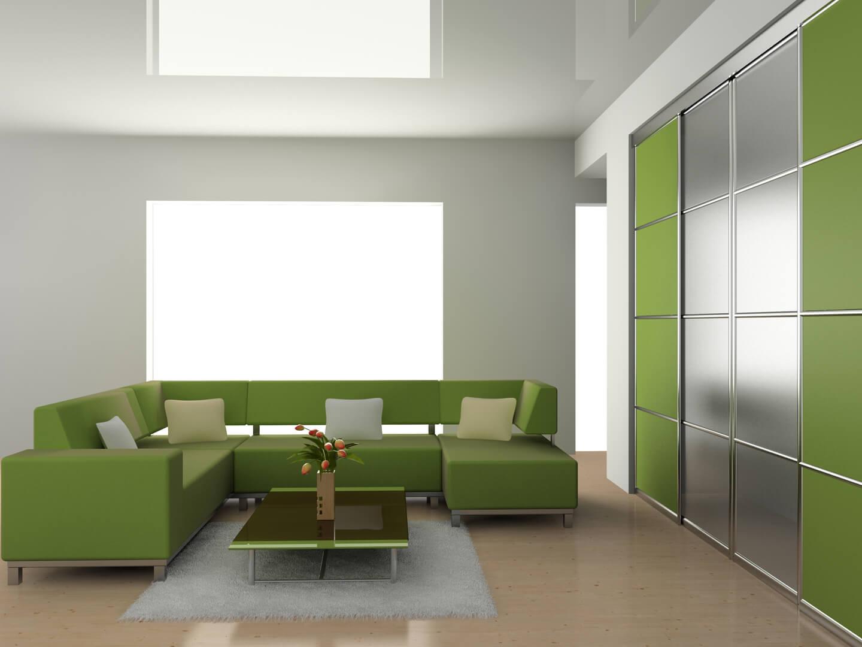 Zielono-srebrna szafa na wymiar z drzwiami przesuwnymi w salonie